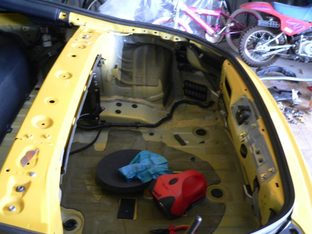 Before trim fitment, there is a clean up and check for room for the battery repositioning at a later date.