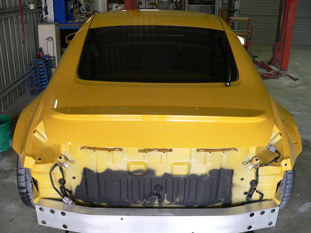 """The rear view shows that I have debadged the vehicle. The glass has been tinted to controll the harsh Queensland sun. New badging will be added when design and casting of the pieces is finished. I will follow the theme of """"brushed aluminium"""" as that matches the door handles, wheels,and stock Z trim."""
