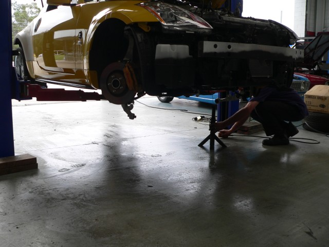 Car is lowered onto three stands, one on each lower control arm mounting points and one under the gearbox.